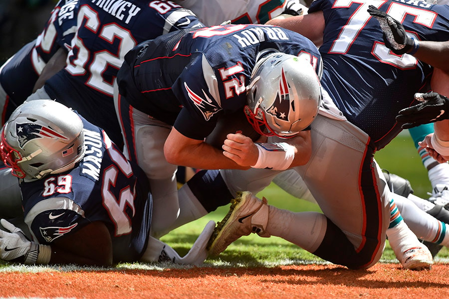 Tom Brady of the New England Patriots scores a touchdown during the third quarter against the Miami Dolphins at Hard Rock Stadium on September 15, 2019 in Miami, Florida. (Photo by Eric Espada/Getty Images)