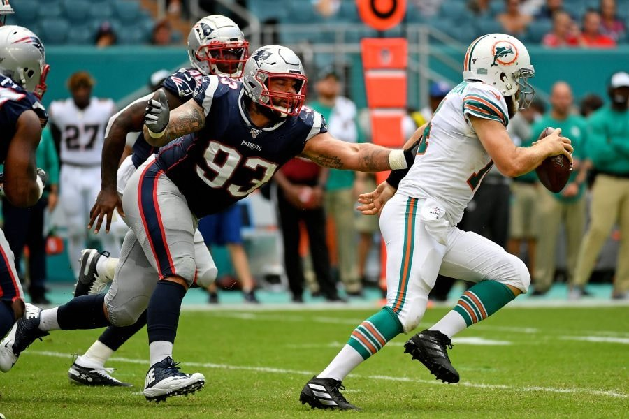 Sep 15, 2019; Miami Gardens, FL: New England Patriots defensive tackle Lawrence Guy reaches for Miami Dolphins quarterback Ryan Fitzpatrick during the second half at Hard Rock Stadium. (Jasen Vinlove-USA TODAY Sports)