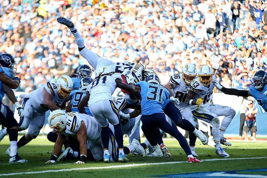 Melvin Gordon III of the Los Angeles Chargers dives over players in an attempt to score a touchdown against the Tennessee Titans during the second quarter at Nissan Stadium on October 20, 2019 in Nashville, Tennessee. (Photo by Silas Walker/Getty Images)