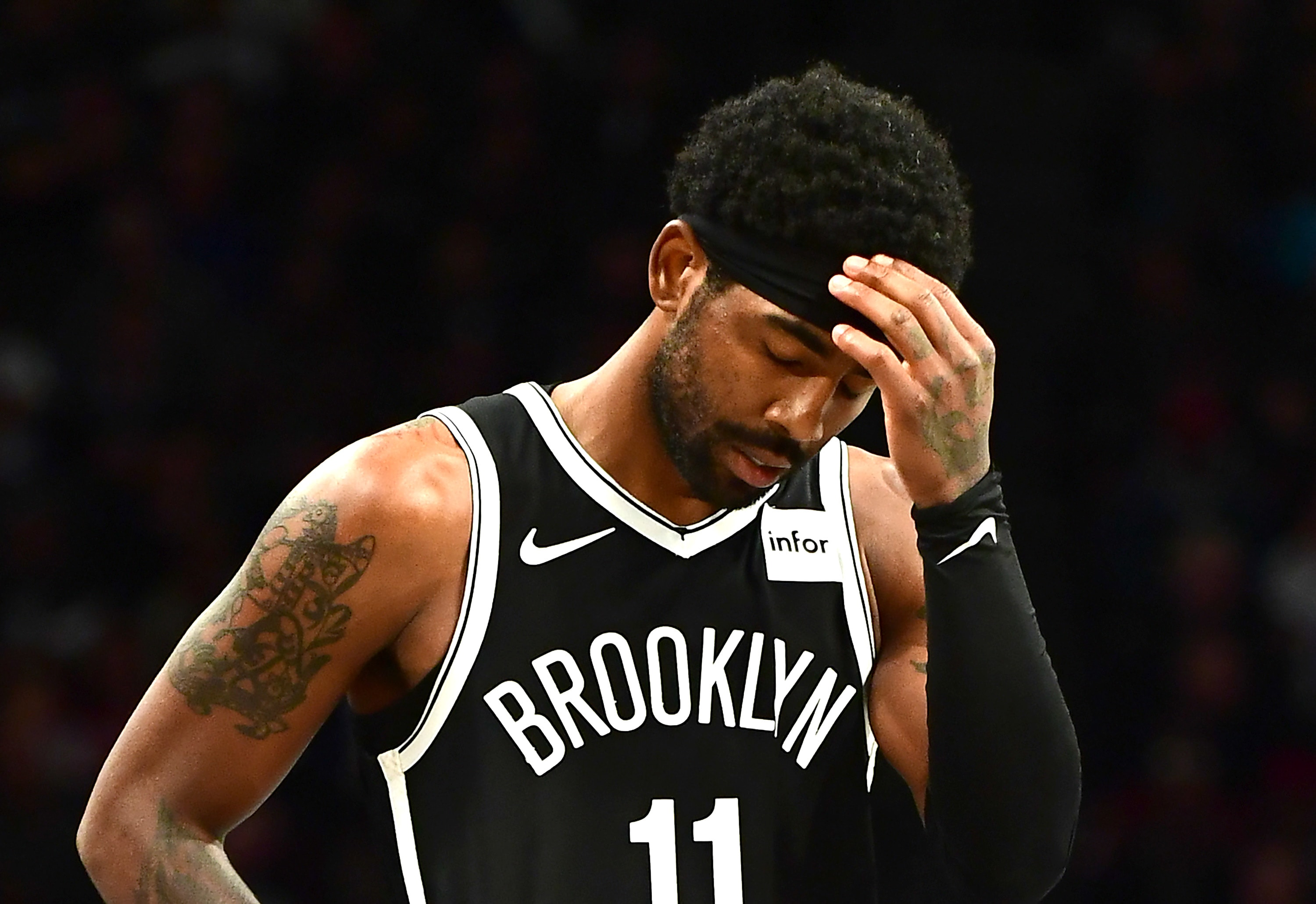 Kyrie Irving of the Brooklyn Nets reacts during the second half of their game against the Minnesota Timberwolves at Barclays Center on October 23, 2019 in the Brooklyn borough of New York City. (Photo by Emilee Chinn/Getty Images)