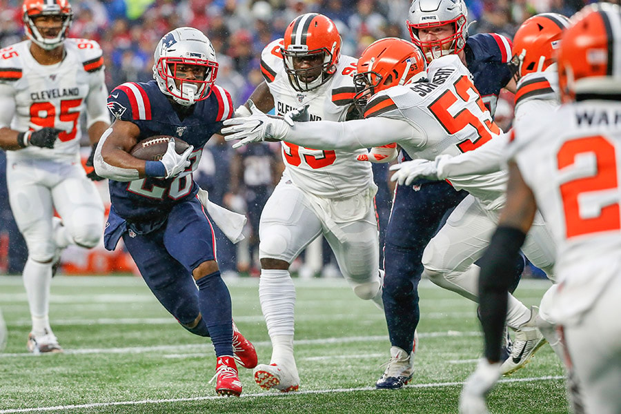Oct 27, 2019; Foxborough, MA: New England Patriots running back James White moves the ball against Cleveland Browns line backer Joe Schobert during the first half at Gillette Stadium. (Greg M. Cooper-USA TODAY Sports)