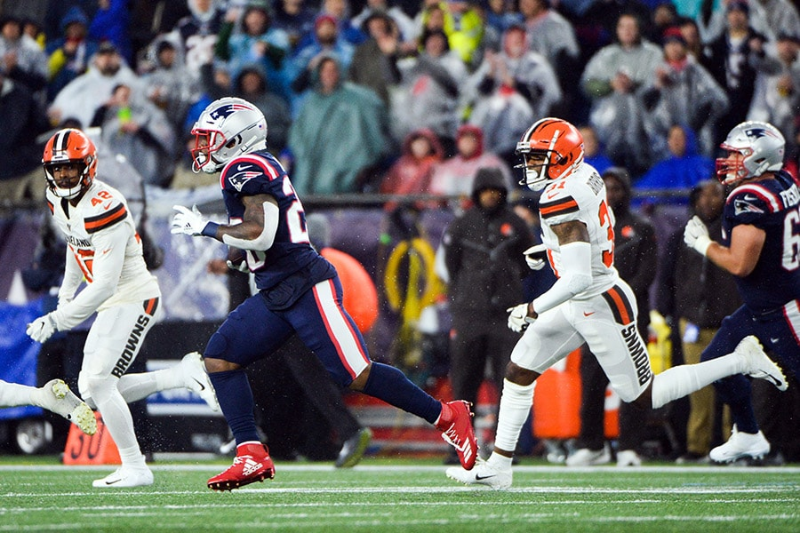 James White of the New England Patriots runs past Juston Burris of the Cleveland Browns in the second half at Gillette Stadium on October 27, 2019 in Foxborough, Massachusetts. (Photo by Kathryn Riley/Getty Images)