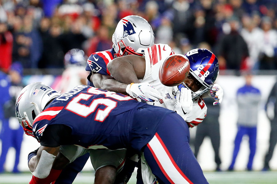 Oct 10, 2019; Foxborough, MA: New York Giants running back Jon Hilliman fumbles the ball after a hit by New England Patriots outside linebacker Jamie Collins during the second half at Gillette Stadium. (Greg M. Cooper-USA TODAY Sports)