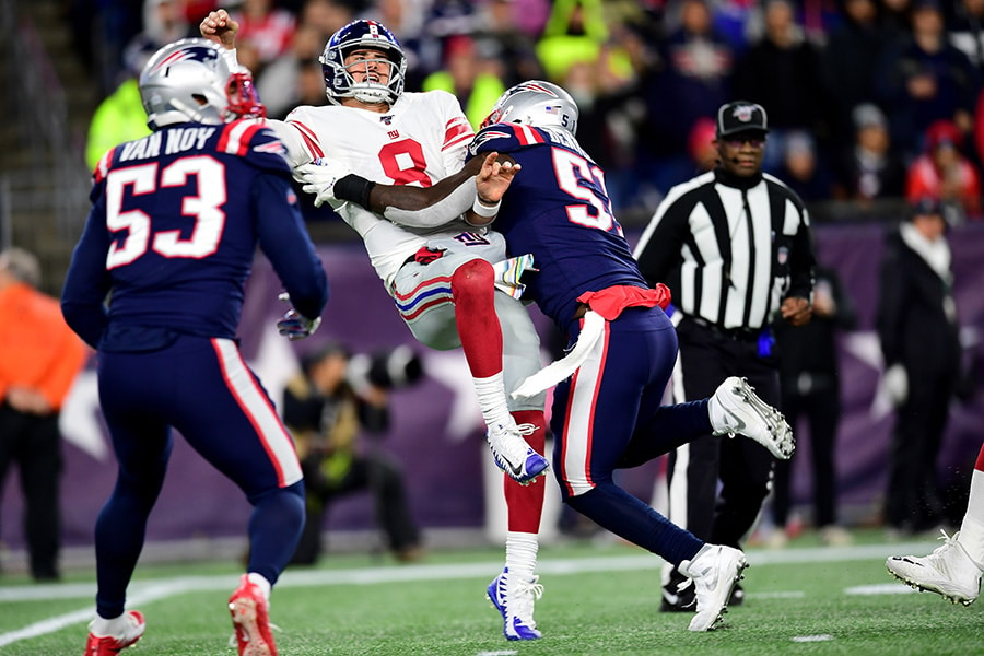 Daniel Jones of the New York Giants gets tackled after throwing a pass against Ja'Whaun Bentley of the New England Patriots during the fourth quarter in the game at Gillette Stadium on October 10, 2019 in Foxborough, Massachusetts. (Photo by Billie Weiss/Getty Images)