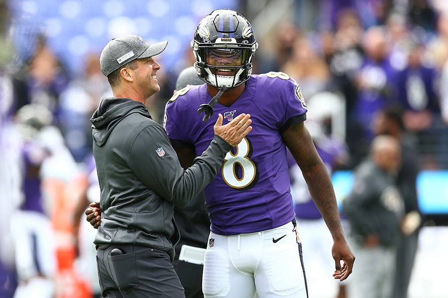 Head coach John Harbaugh interacts with Lamar Jackson of the Baltimore Ravens prior to playing against the Cincinnati Bengals at M&T Bank Stadium on October 13, 2019 in Baltimore, Maryland. (Photo by Dan Kubus/Getty Images)