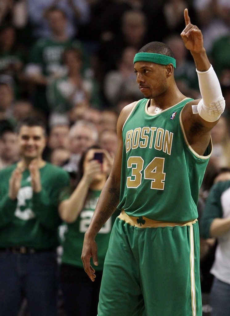 Paul Pierce of the Boston Celtics salutes the cheering crowd after it was announced that tonight was his 1,000th game with the Boston Celtics in the first half against the Portland Trail Blazers on March 9, 2012 at TD Garden in Boston, Massachusetts. (Photo by Elsa/Getty Images)