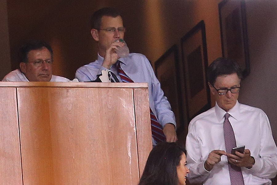 Red Sox executives Sam Kennedy, Tom Werner, John Henry and Dave Dombrowski watch a three-run home run by Yan Gomes of the Cleveland Indians in the eighth inning on August 19, 2015 in Boston, Massachusetts. (Photo by Jim Rogash/Getty Images)