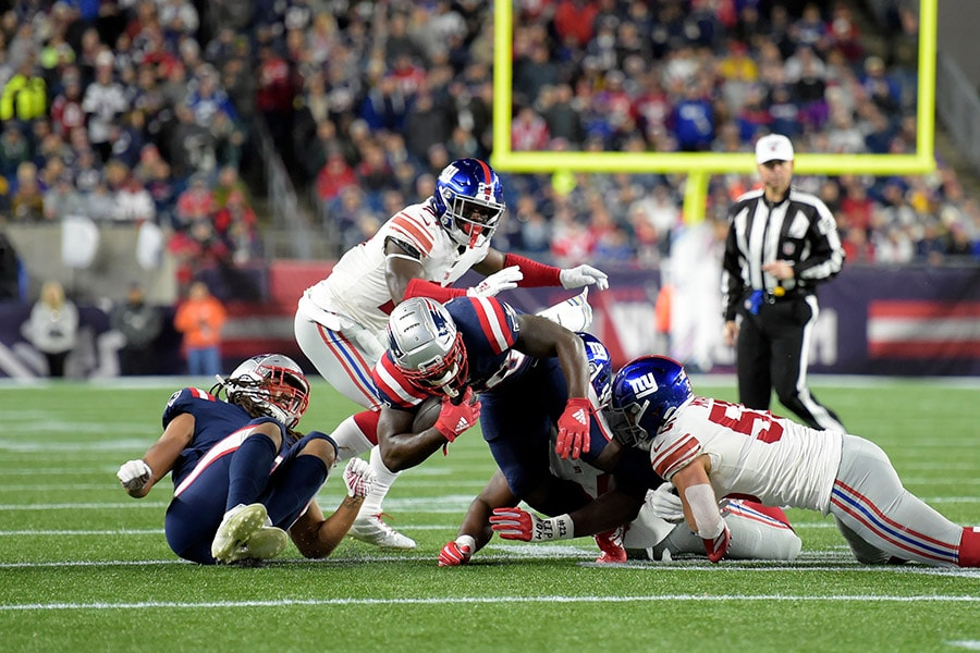 Oct 10, 2019; Foxborough, MA: New England Patriots running back Sony Michel is tacked by New York Giants outside linebacker David Mayo during the first half at Gillette Stadium. (Bob DeChiara-USA TODAY Sports)