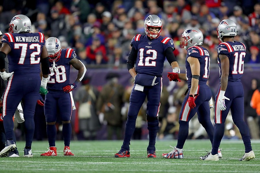 Tom Brady of the New England Patriots talks with Julian Edelman after a play against the New York Giants during the second quarter in the game at Gillette Stadium on October 10, 2019 in Foxborough, Massachusetts. (Photo by Maddie Meyer/Getty Images)