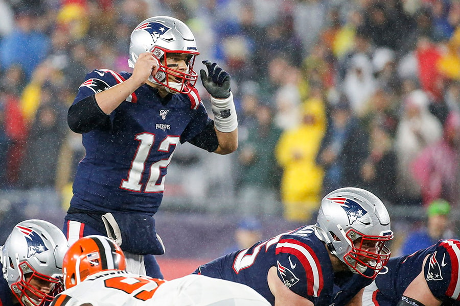 Oct 27, 2019; Foxborough, MA: New England Patriots quarterback Tom Brady makes an adjustment at the line of scrimmage during the second half against the Cleveland Browns at Gillette Stadium. (Greg M. Cooper-USA TODAY Sports)