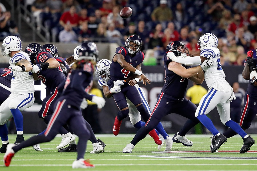 Quarterback Deshaun Watson of the Houston Texans delivers a pass over the defense of the Indianapolis Colts during the game at NRG Stadium on November 21, 2019 in Houston, Texas. (Photo by Tim Warner/Getty Images)