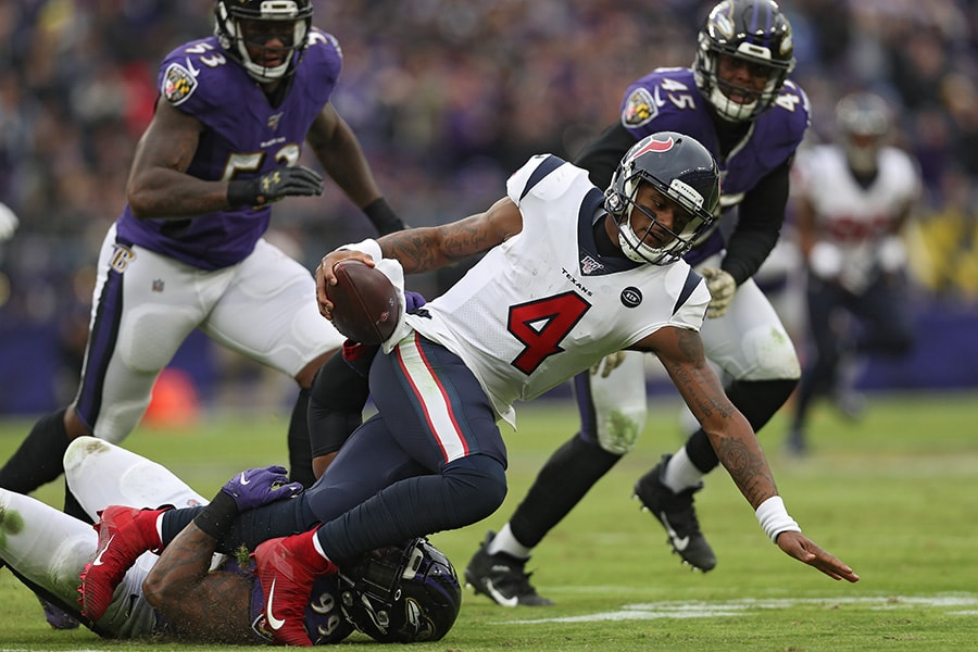 Quarterback Deshaun Watson of the Houston Texans is sacked by outside linebacker Matt Judon of the Baltimore Ravens during the third quarter at M&T Bank Stadium on November 17, 2019 in Baltimore, Maryland. (Photo by Patrick Smith/Getty Images)