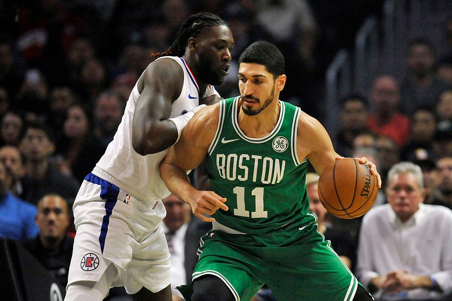 November 20, 2019; Los Angeles, CA: Boston Celtics center Enes Kanter moves the ball against Los Angeles Clippers forward Montrezl Harrell during the first half at Staples Center. (Gary A. Vasquez-USA TODAY)