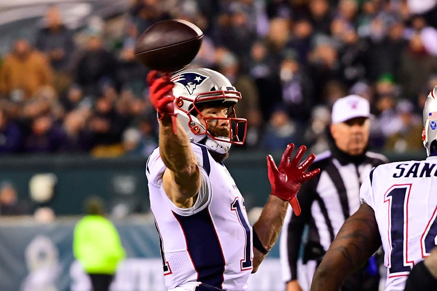 Julian Edelman of the New England Patriots throws a touchdown pass against the Philadelphia Eagles during the third quarter at Lincoln Financial Field on November 17, 2019 in Philadelphia, Pennsylvania. (Photo by Corey Perrine/Getty Images)