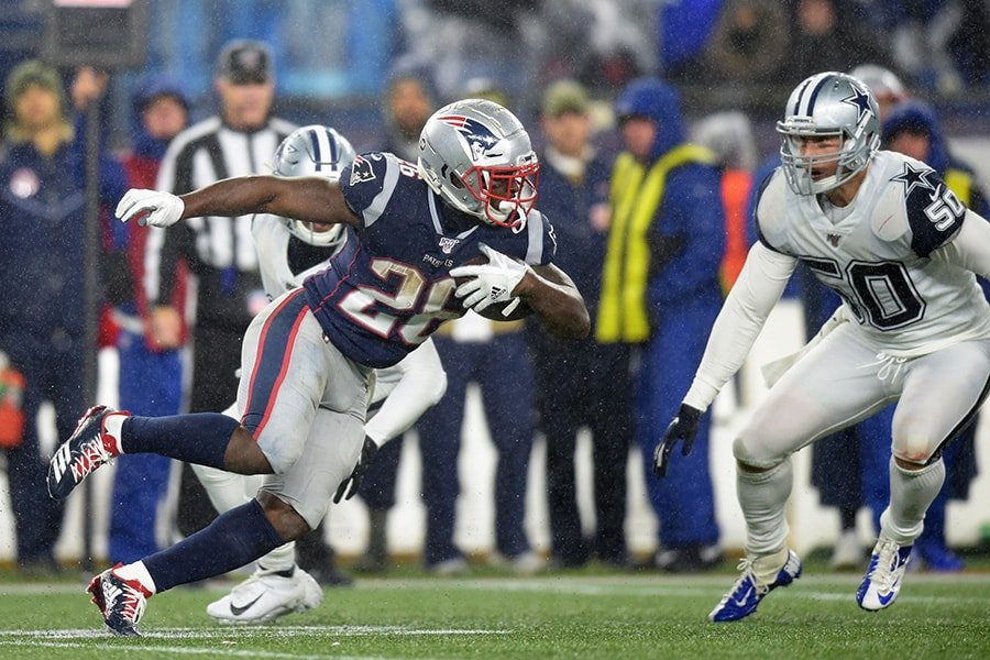 Nov 24, 2019; Foxborough, MA: New England Patriots running back Sony Michel runs with the ball while Dallas Cowboys outside linebacker Sean Lee defends during the second half at Gillette Stadium. (Bob DeChiara-USA TODAY Sports)