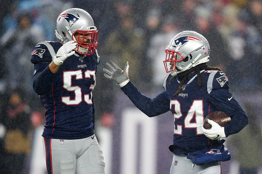 Nov 24, 2019; Foxborough, MA: New England Patriots cornerback Stephon Gilmore is congratulated by middle linebacker Kyle Van Noy after making an interception during the first half against the Dallas Cowboys at Gillette Stadium. (Bob DeChiara-USA TODAY Sports)