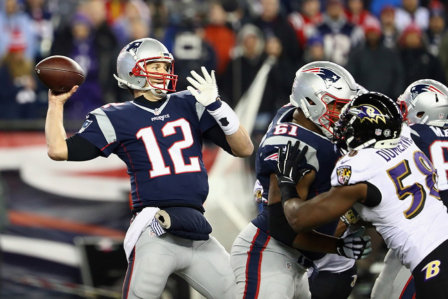 Tom Brady of the New England Patriots throws a pass during the second half against the Baltimore Ravens at Gillette Stadium on December 12, 2016 in Foxboro, Massachusetts. (Photo by Adam Glanzman/Getty Images)