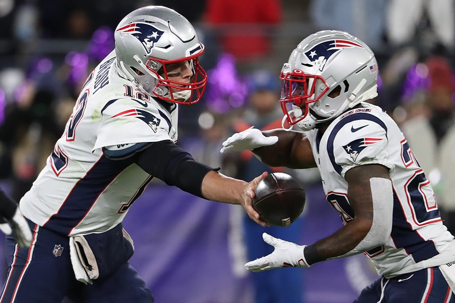 Tom Brady of the New England Patriots hands-off to running back James White of the New England Patriots against the Baltimore Ravens during the second quarter at M&T Bank Stadium on November 3, 2019 in Baltimore, Maryland. (Photo by Todd Olszewski/Getty Images)