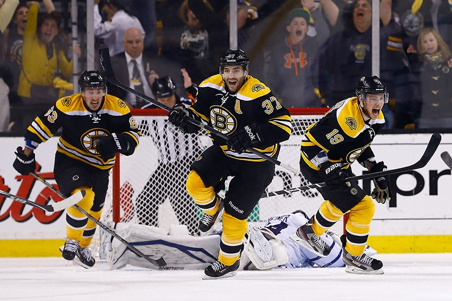 Patrice Bergeron, Tyler Seguin, and Brad Marchand of the Boston Bruins celebrate following Bergeron's game-winning overtime goal against the Toronto Maple Leafs in Game Seven of the Eastern Conference Quarterfinals during the 2013 NHL Stanley Cup Playoffs on May 13, 2013 at TD Garden in Boston, Massachusetts. (Photo by Jared Wickerham/Getty Images)