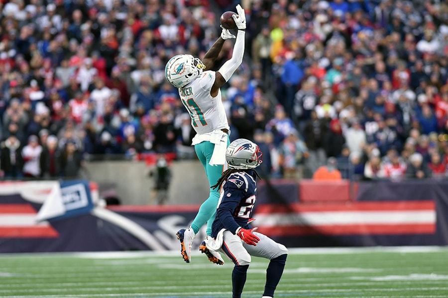 Dec 29, 2019; Foxborough, Massachusetts, USA; Miami wide receiver DeVante Parker makes a catch over New England Patriots cornerback Stephon Gilmore during the second half at Gillette Stadium. (Bob DeChiara-USA TODAY Sports)