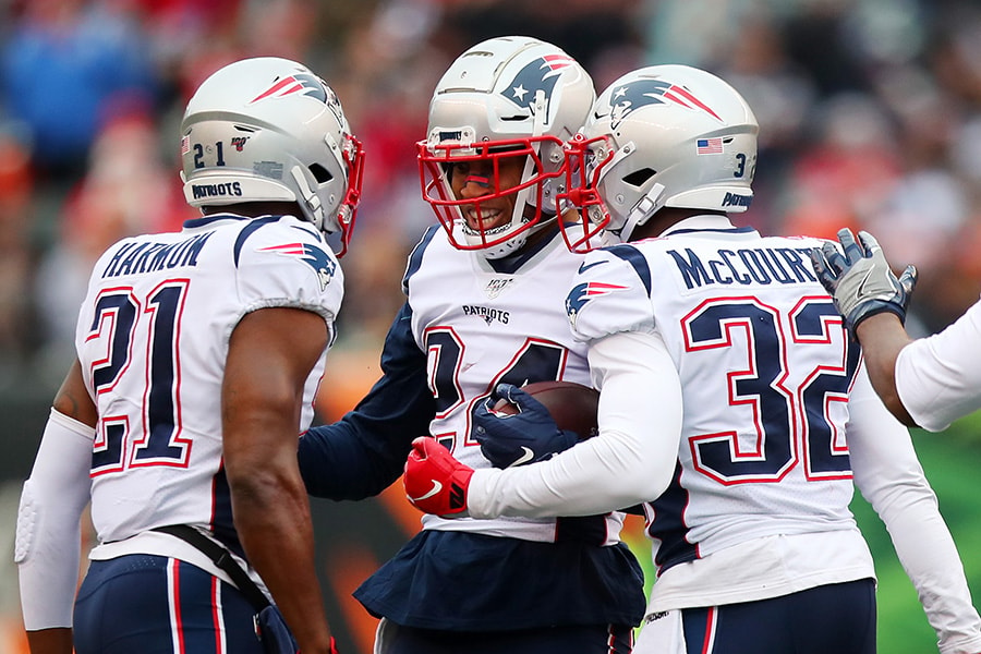 Stephon Gilmore of the New England Patriots celebrates with teammates after intercepting a pass during the third quarter against the Cincinnati Bengals in the game at Paul Brown Stadium on December 15, 2019 in Cincinnati, Ohio. (Photo by Bobby Ellis/Getty Images)