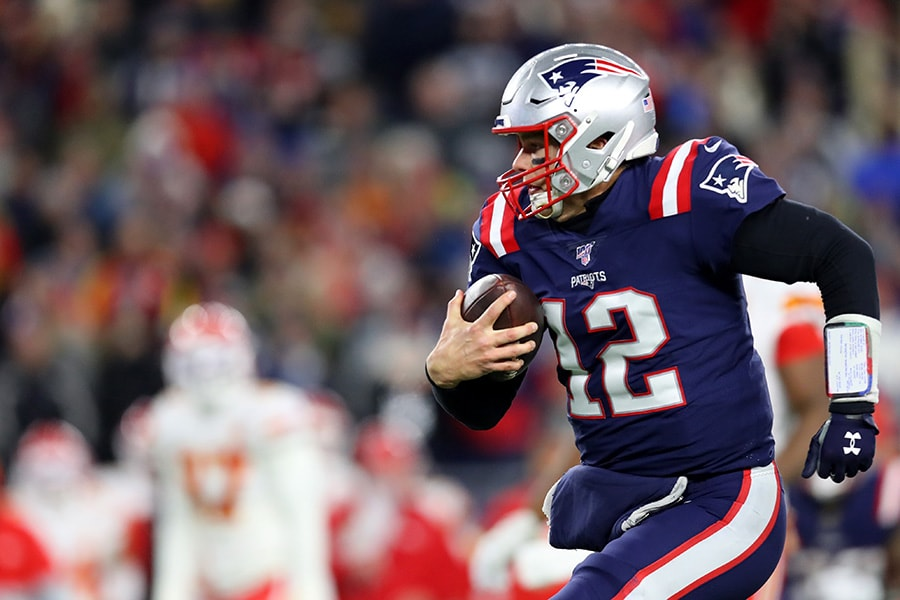 Tom Brady of the New England Patriots runs the ball during the game against the Kansas City Chiefs at Gillette Stadium on December 08, 2019 in Foxborough, Massachusetts. (Photo by Maddie Meyer/Getty Images)