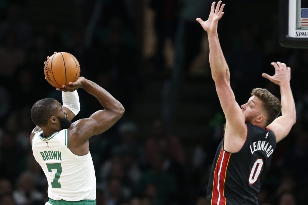 Dec 4, 2019; Boston, MA: Boston Celtics guard Jaylen Brown puts up a shot while guarded by Miami Heat center Meyers Leonard during the first half at TD Garden. (Greg M. Cooper-USA TODAY Sports)