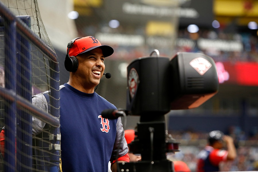 ST. PETERSBURG, FL - AUGUST 26: Manager Alex Cora #20 of the Boston Red Sox gives an on-field interview during the third inning of a game against the Tampa Bay Rays on August 26, 2018 at Tropicana Field in St. Petersburg, Florida. All players across MLB will wear nicknames on their backs as well as colorful, non-traditional uniforms featuring alternate designs inspired by youth-league uniforms during Players Weekend. (Photo by Brian Blanco/Getty Images)