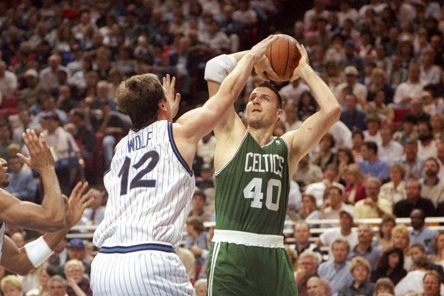 31 Jan 1996: Forward Dino Radja of the Boston Celtics tries to pass the ball as forward Joe Wolf of the Orlando Magic guards him during a game at Orlando Arena in Orlando, Florida. The Magic won the game 104 - 99. (Getty Images)