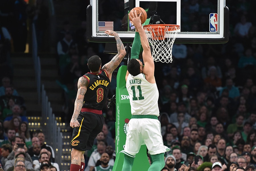 Dec 9, 2019; Boston, MA, USA; Cleveland Cavaliers guard Jordan Clarkson (8) and Boston Celtics center Enes Kanter (11) battle for a rebound during the second half at TD Garden. Mandatory Credit: Bob DeChiara-USA TODAY Sports