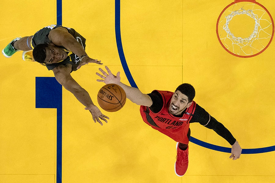 May 16, 2019; Oakland, CA, USA; Portland Trail Blazers center Enes Kanter (00) and Golden State Warriors center Kevon Looney (5) fight for a rebound during the first half in game two of the Western conference finals of the 2019 NBA Playoffs at Oracle Arena. Mandatory Credit: Kyle Terada-USA TODAY Sports