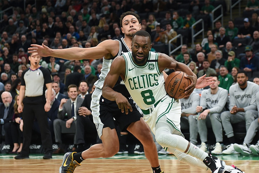 Jan 8, 2020; Boston, Massachusetts, USA; Boston Celtics guard Kemba Walker (8) moves to the basket past San Antonio Spurs guard Bryn Forbes (11) during the first half at TD Garden. Mandatory Credit: Bob DeChiara-USA TODAY Sports