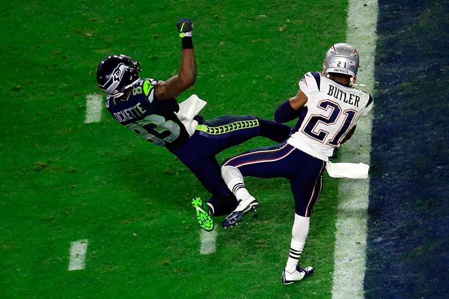 GLENDALE, AZ - FEBRUARY 01: Malcolm Butler #21 of the New England Patriots intercepts a pass by Russell Wilson #3 of the Seattle Seahawks intended for Ricardo Lockette #83 late in the fourth quarter during Super Bowl XLIX at University of Phoenix Stadium on February 1, 2015 in Glendale, Arizona. (Photo by Jamie Squire/Getty Images)