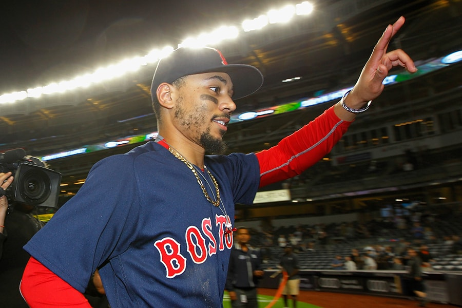 NEW YORK, NY - SEPTEMBER 20: Mookie Betts #50 of the Boston Red Sox waves to fans as he leaves the field after defeating the New York Yankees to clinch the American League East at Yankee Stadium on September 20, 2018 in the Bronx borough of New York City. (Photo by Jim McIsaac/Getty Images)