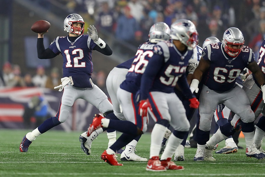 FOXBOROUGH, MASSACHUSETTS - JANUARY 04: Tom Brady #12 of the New England Patriots throws a pass against the Tennessee Titans in the AFC Wild Card Playoff game at Gillette Stadium on January 04, 2020 in Foxborough, Massachusetts. The Titans won 20-13. (Photo by Maddie Meyer/Getty Images)