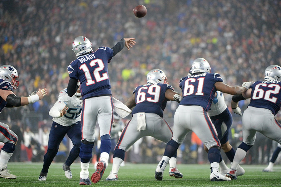 FOXBOROUGH, MASSACHUSETTS - JANUARY 04: Tom Brady #12 of the New England Patriots throws a pass during the second half against the Tennessee Titans in the AFC Wild Card Playoff game at Gillette Stadium on January 04, 2020 in Foxborough, Massachusetts. (Photo by Kathryn Riley/Getty Images)