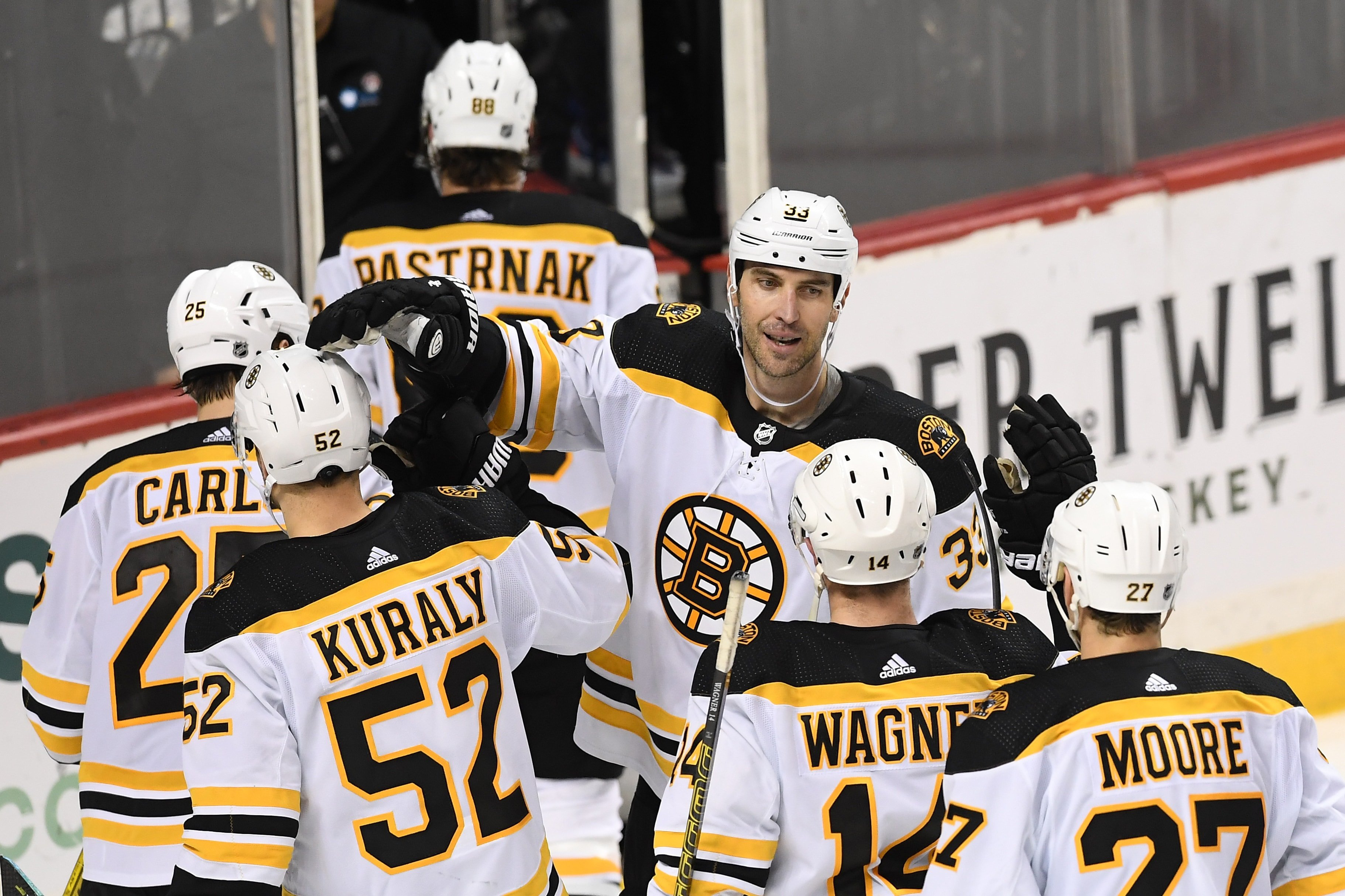 Bruins set franchise record, move atop NHL standings with overtime win over Isles