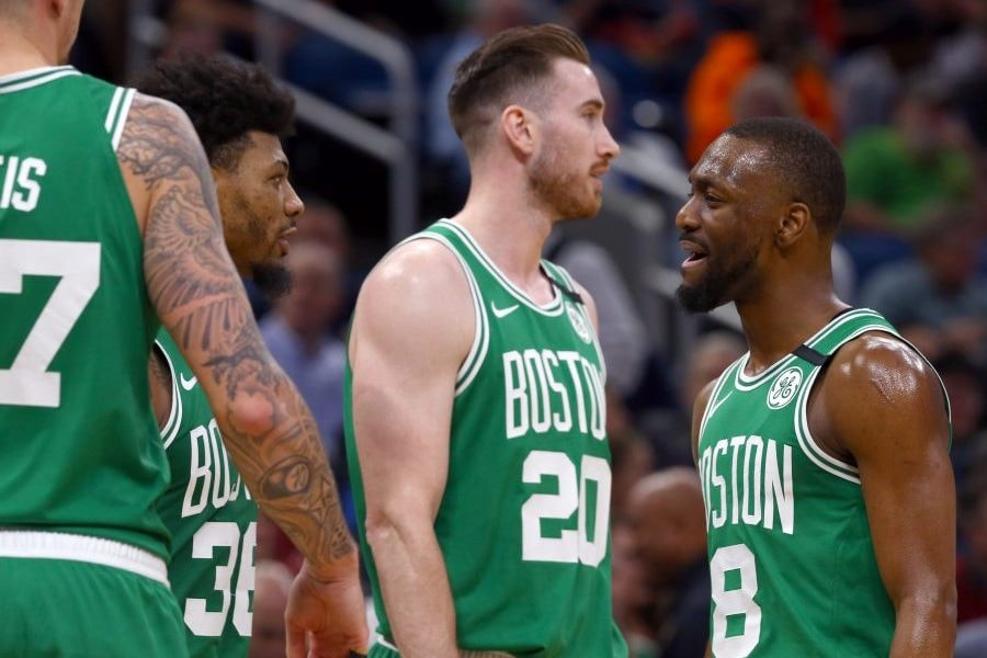 Jan 24, 2020; Orlando, Florida, USA; Boston Celtics guard Kemba Walker (8) talks with guard Marcus Smart (36) and forward Gordon Hayward (20) and center Daniel Theis (27) against the Orlando Magic during the first quarter at Amway Center. Mandatory Credit: Kim Klement-USA TODAY Sports
