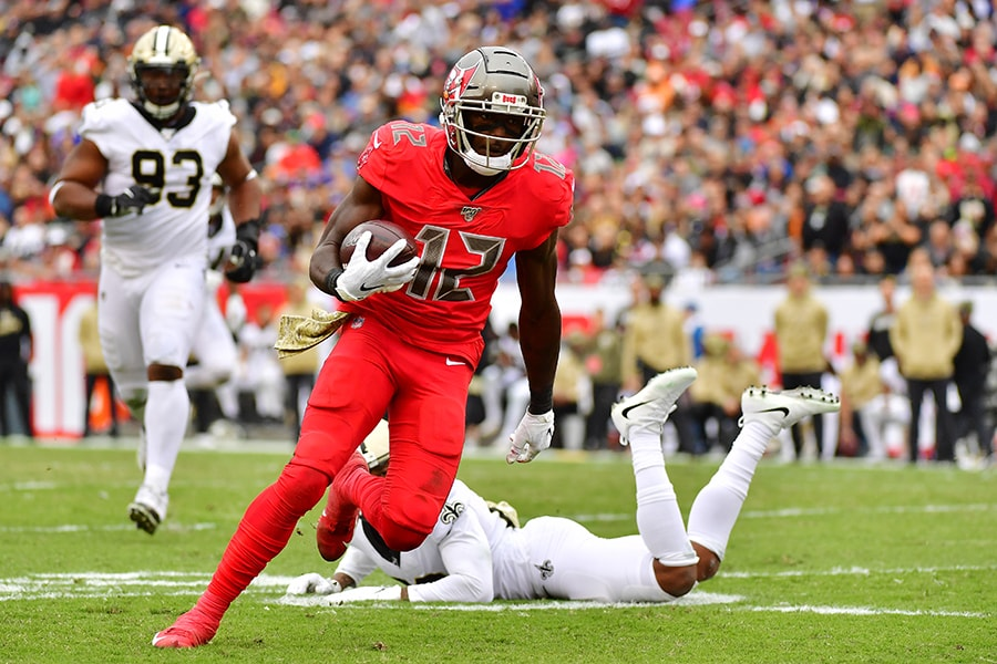 TAMPA, FLORIDA - NOVEMBER 17: Chris Godwin #12 of the Tampa Bay Buccaneers catches a 30-yard reception to score during the third quarter of a football game against the New Orleans Saints at Raymond James Stadium on November 17, 2019 in Tampa, Florida. (Photo by Julio Aguilar/Getty Images)