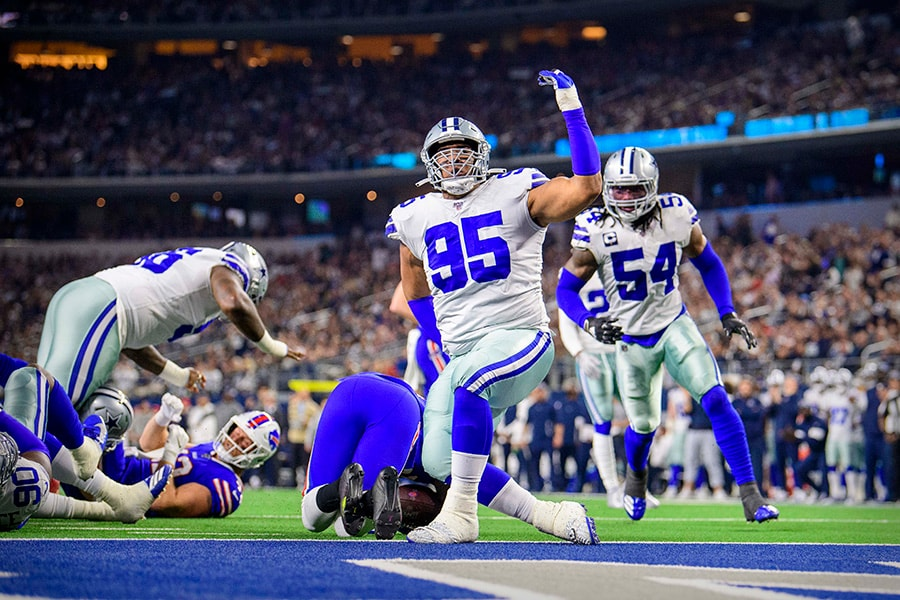 Nov 28, 2019; Arlington, TX, USA; Dallas Cowboys defensive end Christian Covington (95) celebrates making a tackle of Buffalo Bills running back Frank Gore (20) during the first quarter at AT&T Stadium. Mandatory Credit: Jerome Miron-USA TODAY Sports