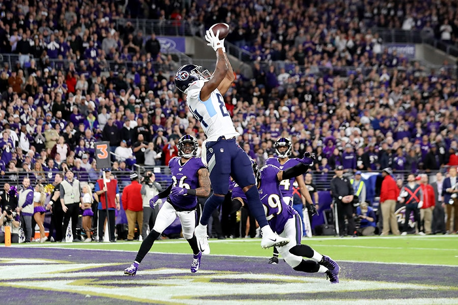 BALTIMORE, MARYLAND - JANUARY 11: Corey Davis #84 of the Tennessee Titans catches a touchdown pass during the third quarter against the Baltimore Ravens in the AFC Divisional Playoff game at M&T Bank Stadium on January 11, 2020 in Baltimore, Maryland. (Photo by Rob Carr/Getty Images)