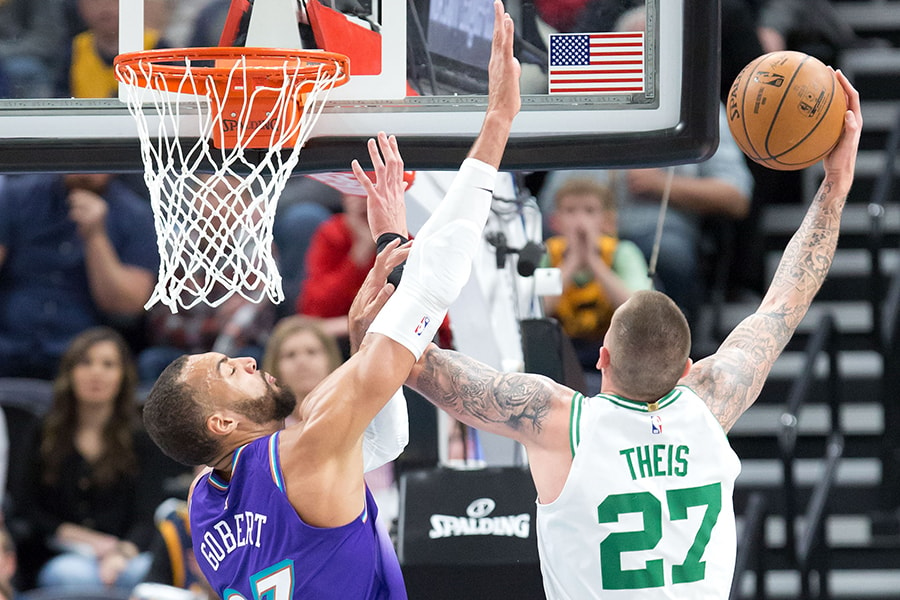 Feb 26, 2020; Salt Lake City, Utah, USA; Boston Celtics center Daniel Theis (27) shoots the ball against Utah Jazz center Rudy Gobert (27) during the first quarter at Vivint Smart Home Arena. Mandatory Credit: Russell Isabella-USA TODAY Sports