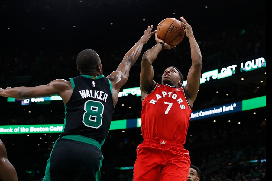 Dec 28, 2019; Boston, Massachusetts, USA; Toronto Raptors guard Kyle Lowry (7) shoots over Boston Celtics guard Kemba Walker (8) during the second quarter at TD Garden. Mandatory Credit: Winslow Townson-USA TODAY Sports