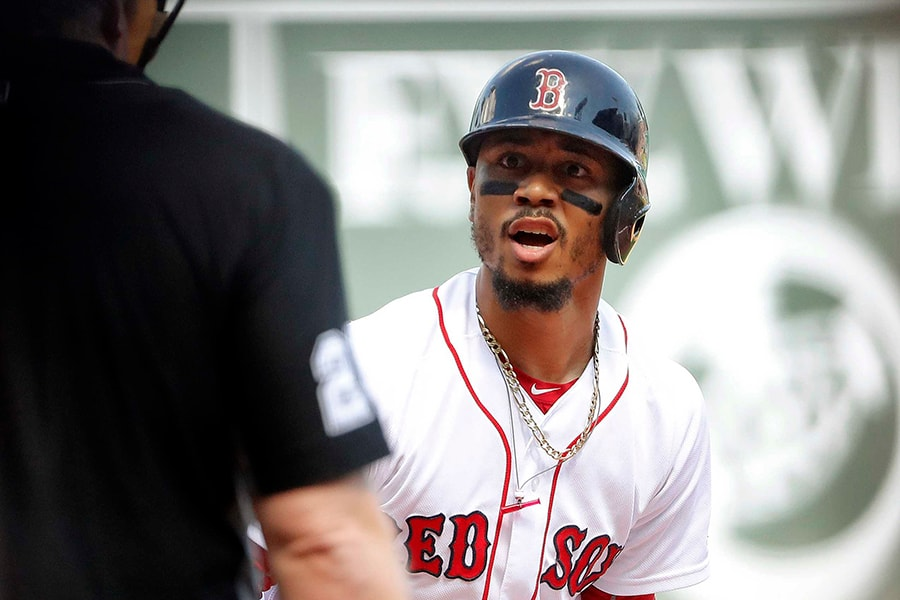 Sep 16, 2018; Boston, MA, USA; Boston Red Sox right fielder Mookie Betts (50) looks at umpire Bill Miller (26) after being called out on strikes during the first inning against the New York Mets at Fenway Park. Mandatory Credit: Winslow Townson-USA TODAY Sports
