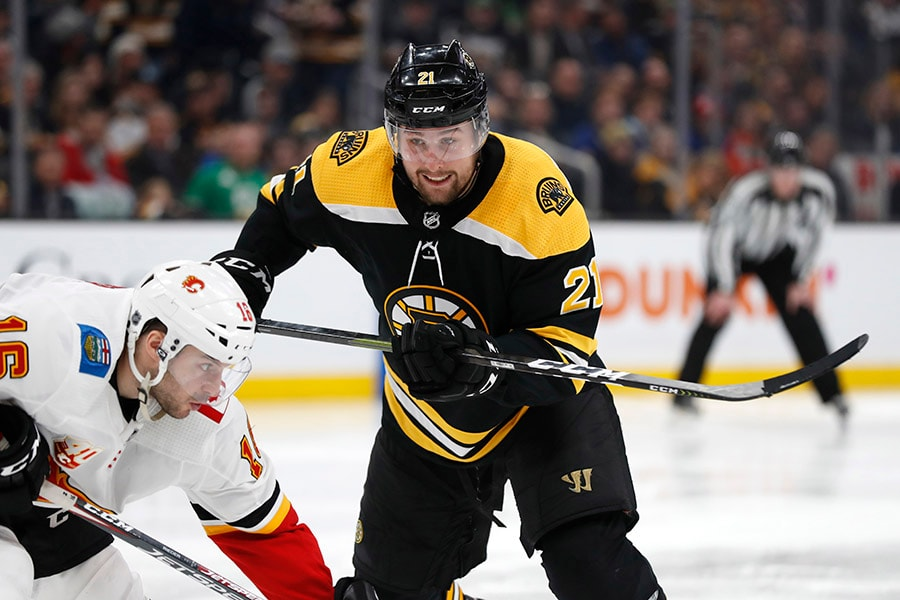 Feb 25, 2020; Boston, Massachusetts, USA; Newly acquired Boston Bruins left wing Nick Ritchie (21) plays against Calgary Flames center Tobias Rieder (16) during the third period at TD Garden. Mandatory Credit: Winslow Townson-USA TODAY Sports