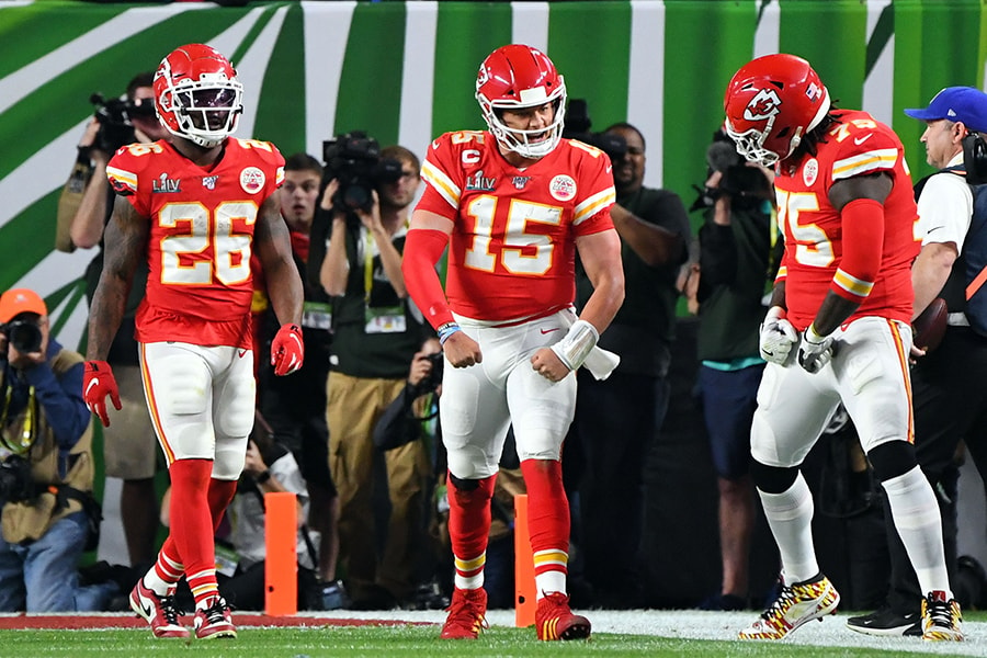 Feb 2, 2020; Miami Gardens, Florida, USA; Kansas City Chiefs quarterback Patrick Mahomes (15) celebrates with running back Damien Williams (26) and offensive tackle Cameron Erving (75) after scoring a touchdown during the first quarter against the San Francisco 49ers in Super Bowl LIV at Hard Rock Stadium. Mandatory Credit: Robert Deutsch-USA TODAY Sports