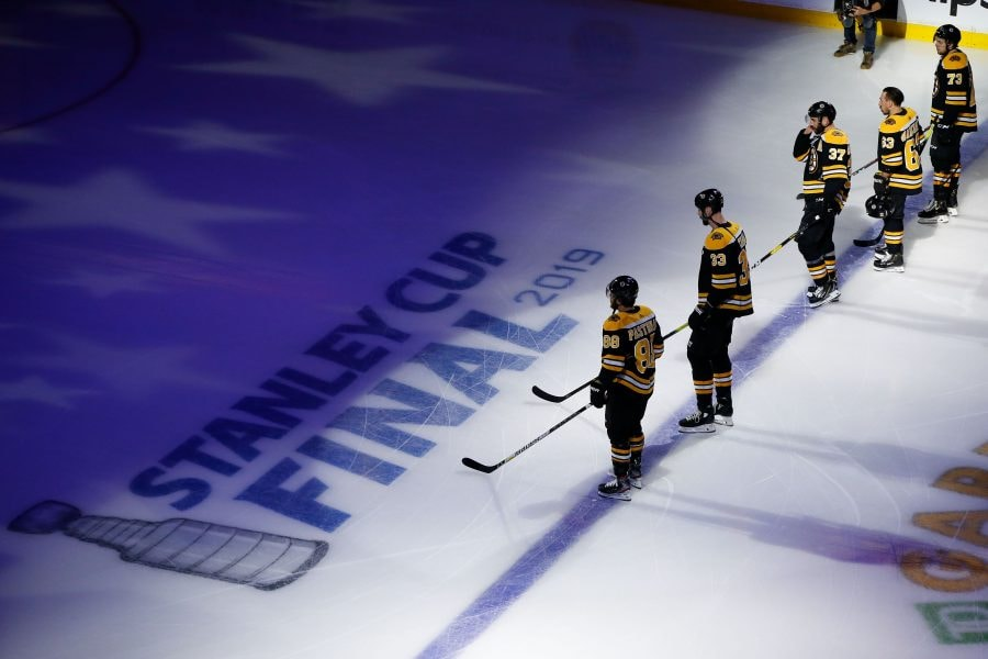 May 29, 2019; Boston, MA, USA; A gen eral view of the Boston Bruins and the Stanley Cup logo during the National Anthem before a game against the St. Louis Blues during the first period in game two of the 2019 Stanley Cup Final at TD Garden. Mandatory Credit: Greg M. Cooper-USA TODAY Sports