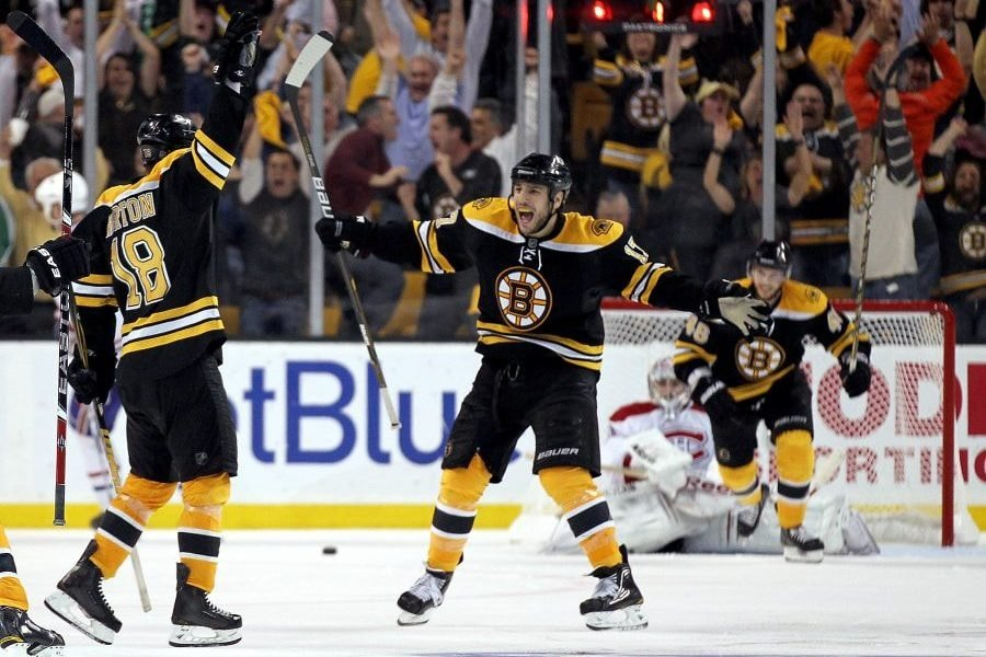 BOSTON, MA - APRIL 27: Nathan Horton #18 of the Boston Bruins celebrates with Milan Lucic #17 after Horton scored the winning goal in overtime against the Montreal Canadiens in Game Seven of the Eastern Conference Quarterfinals during the 2011 NHL Stanley Cup Playoffs at TD Garden on April 27, 2011 in Boston, Massachusetts. (Photo by Jim Rogash/Getty Images)