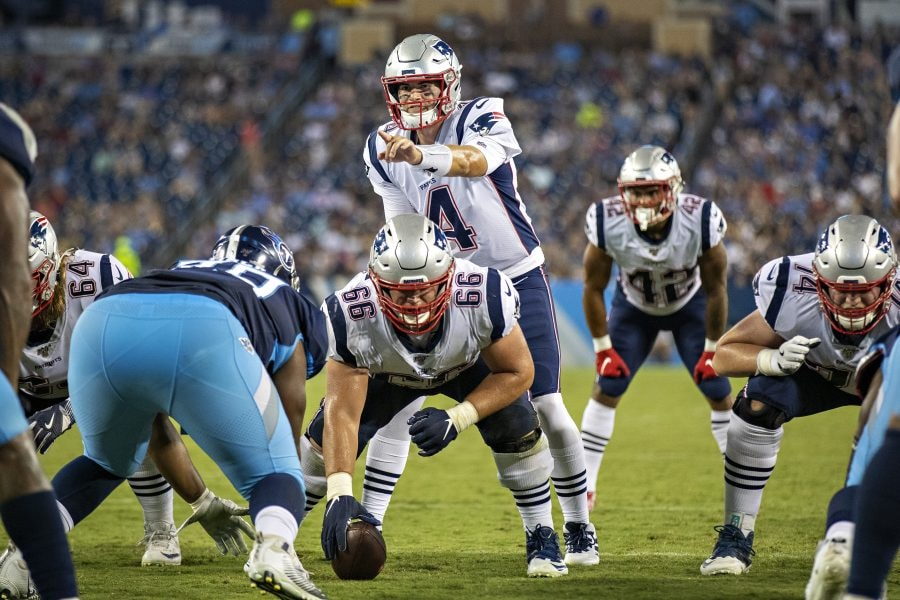 NASHVILLE, TN - AUGUST 17: Jarrett Stidham #4 of the New England Patriots points out the blocking assignment during a week two preseason game against the Tennessee Titans at Nissan Stadium on August 17, 2019 in Nashville, Tennessee. The Patriots defeated the Titans 22-17. (Photo by Wesley Hitt/Getty Images)