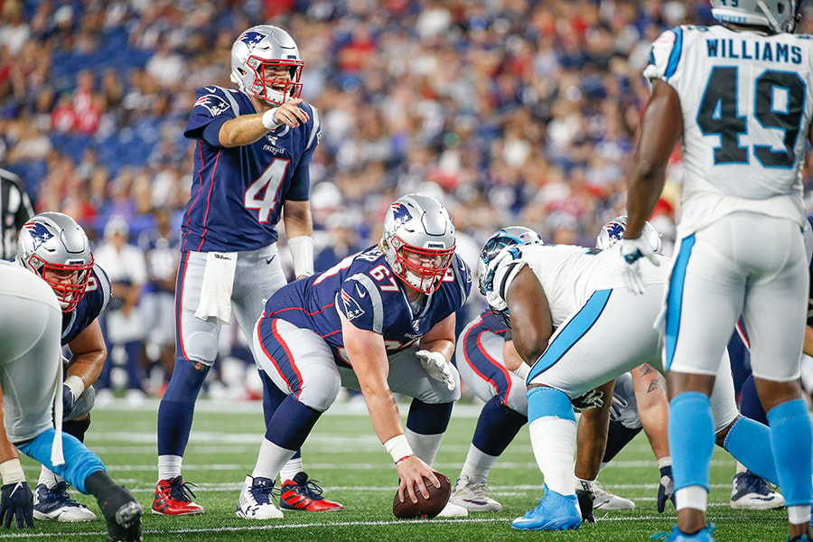 Aug 22, 2019; Foxborough, MA, USA; New England Patriots quarterback Jarrett Stidham (4) makes an adjustment at the line of scrimmage while standing behind center Tyler Gauthier (67) during the second half against the Carolina Panthers at Gillette Stadium. Mandatory Credit: Greg M. Cooper-USA TODAY Sports